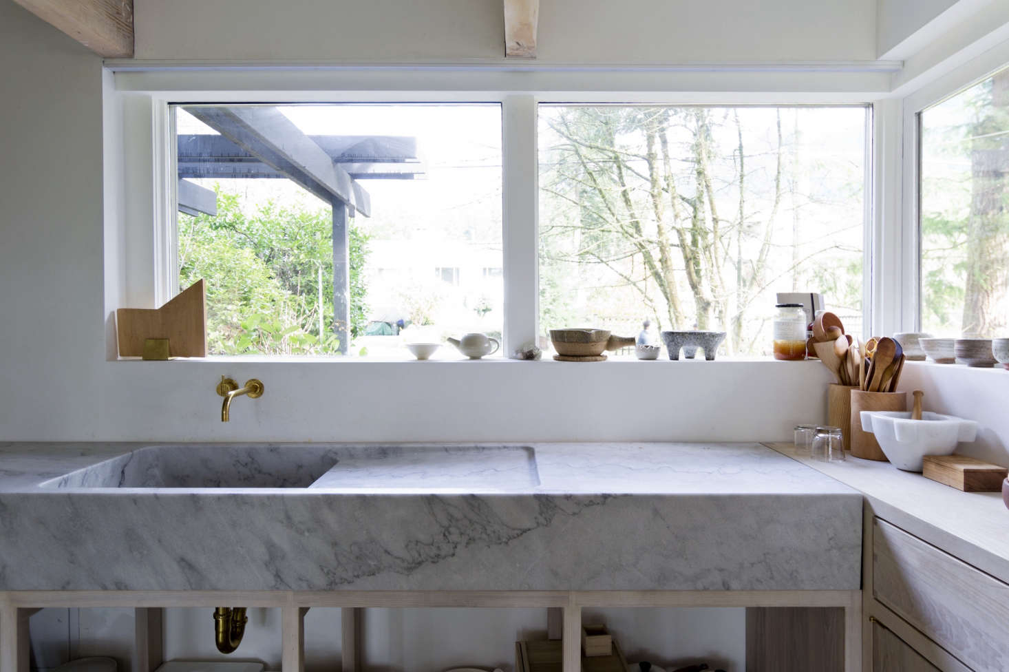 An integrated marble sink (with drain board) carved from a huge slab of marble from the Hisnet Inlet quarry on Vancouver Island, as seen in one of our favorite kitchens of all time: Kitchen of the Week: A Monumental Marble Countertop. Photograph courtesy of Scott & Scott Architects.
