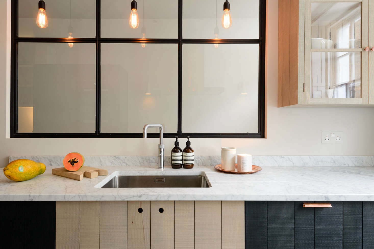 Stained black wood-paneled kitchen: The Marylebone London Galley by Simon Cox for DeVol   Remodelista