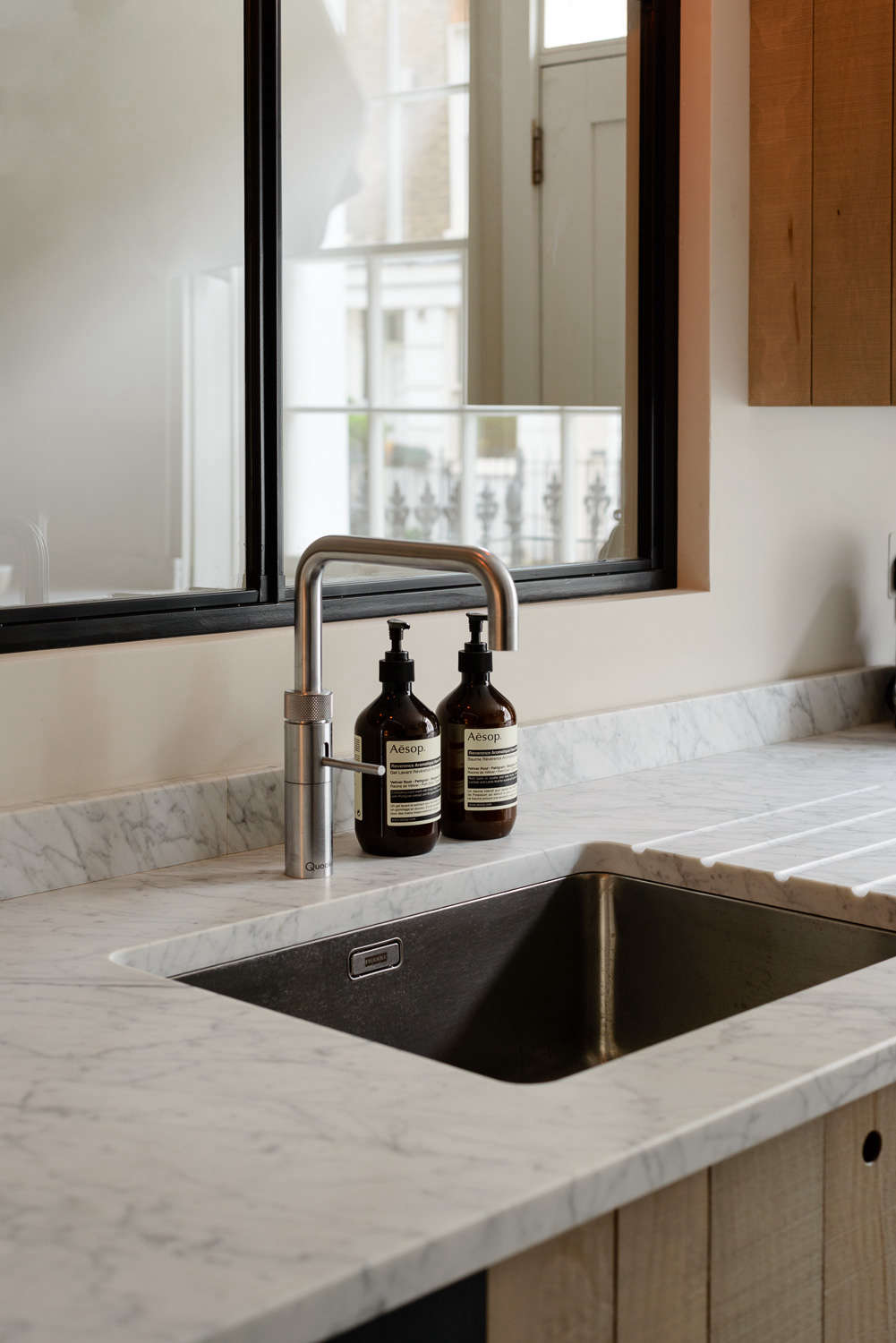Honed Carrara marble sink counter in the the Marylebone London Galley by Simon Cox for DeVol   Remodelista