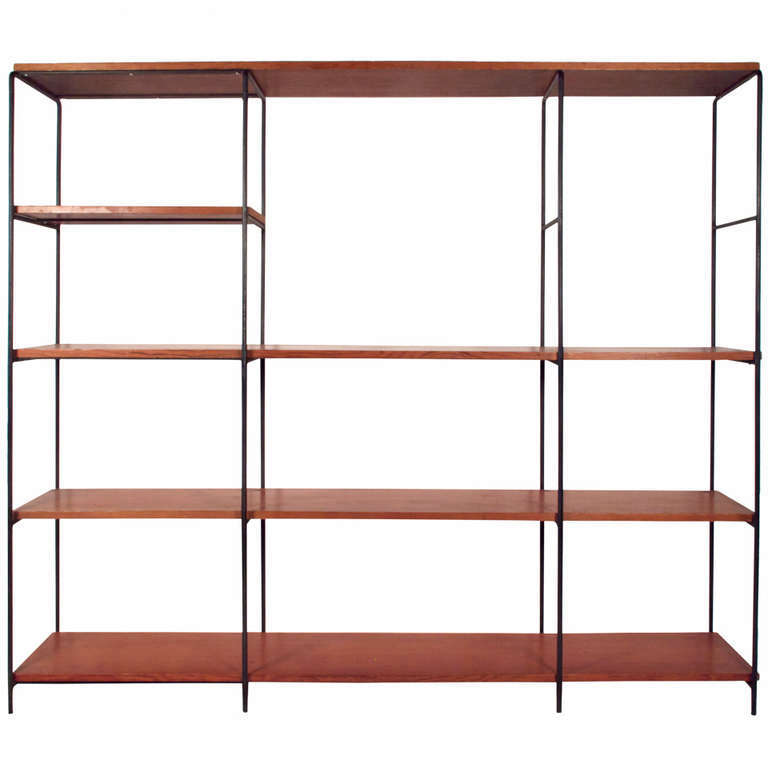 A Muriel Coleman Iron and Wood Wall Shelf,which can be used as a room divider, was previously available from Just in Modern via src=