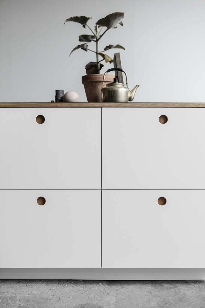A Sixties-Inspired Danish Ikea Hack, Now Coming to America, includes subtle circular cutout pulls.