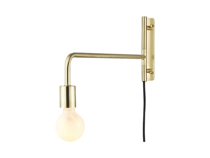 10 easy pieces simple swing arm wall lights remodelista cb2 swing arm brass wall sconce remodelista mozeypictures Choice Image