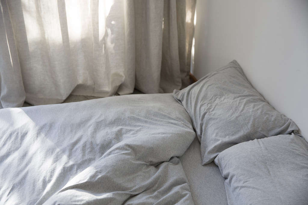 dehei-light-gray-bedding-remodelista-1