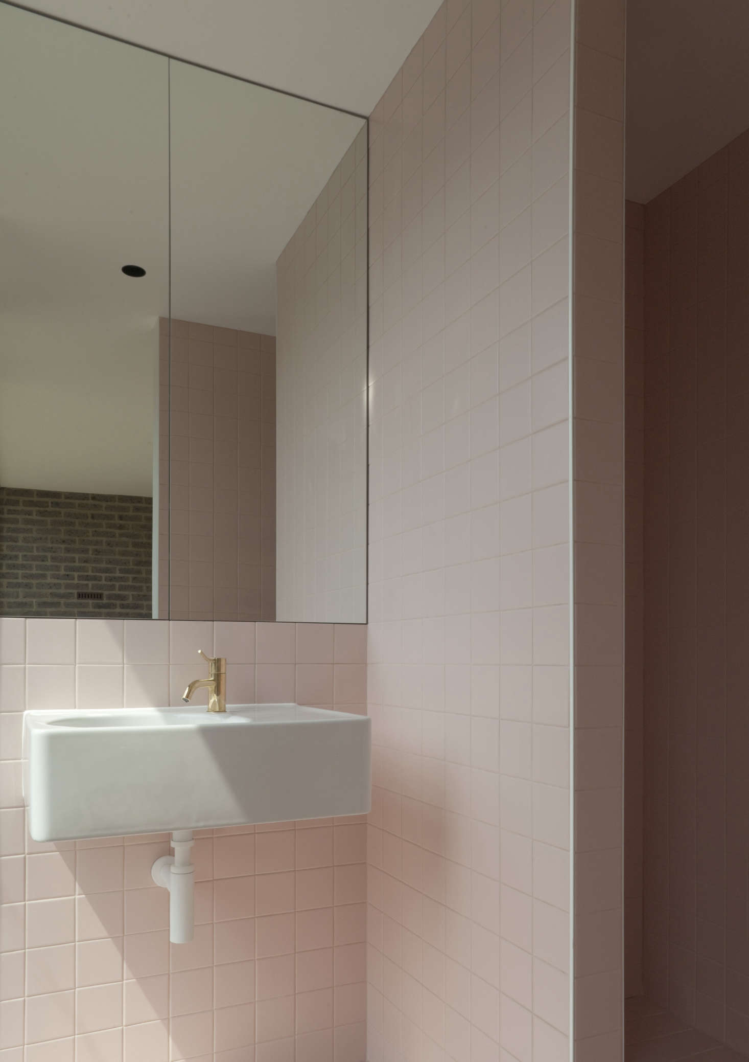 A modern take on a retro trend in this bath, tiled floor to ceiling in subtle pink by London-based Duggan Morris Architects. Photograph byMark Hadden.