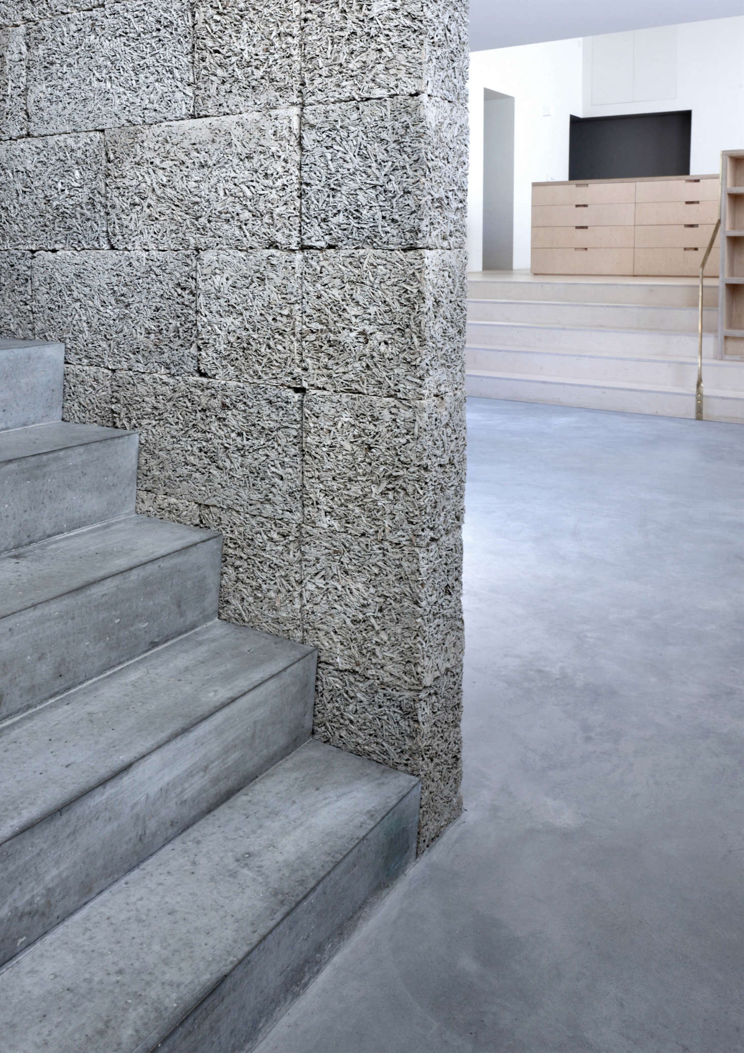 The stairwall is made of dry-stacked Durisol Wood-Cement Walling Units.