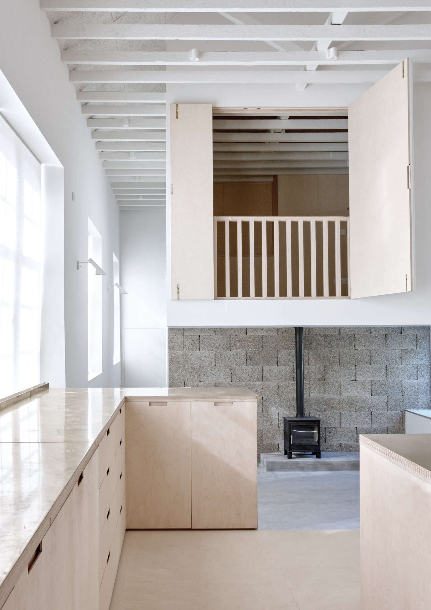 Thesecond-story bedroom—with shutters and railing that open it to the light and life downstairs—appears to float overhead. How were the architects able to pull off this legerdemain?