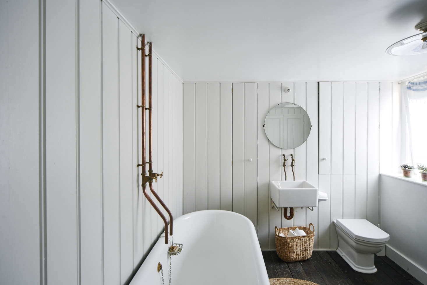 Photograph by Matt Lincoln fromA Historic House Reimagined for a Modern Family in Stroud, England(plus a smart work-around for the plumbing issue: mount the tub closer to the wall).