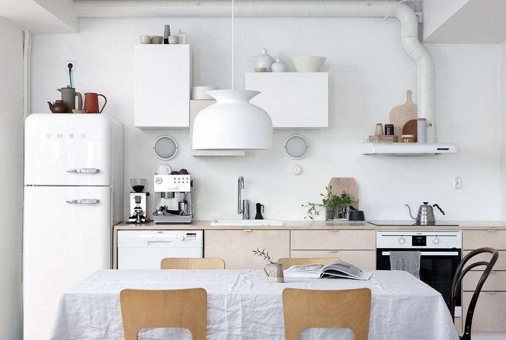 Stylist Anna Pirkola's kitchen in Helsinki has a Gubi Ronde Pendantlight of spun aluminum; see more atKitchen of the Week: A Stylist's $3,400 Kitchen Makeover, DIY Scandi Edition.