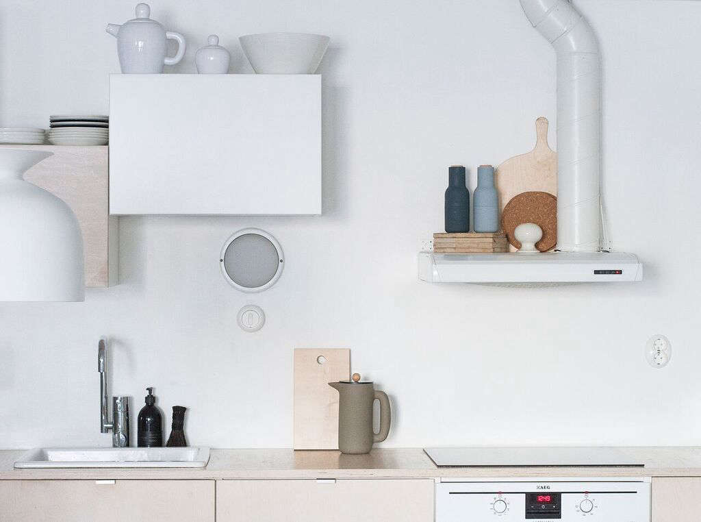 """The metal tab hardware on the cabinets is also from Ikea: """"We weren't sure if we wanted to have leather pullsor something else, so we bought these to use for the time being because they don't leave any marks on the outside of the cabinets. And yes, they have been there quite a while."""""""