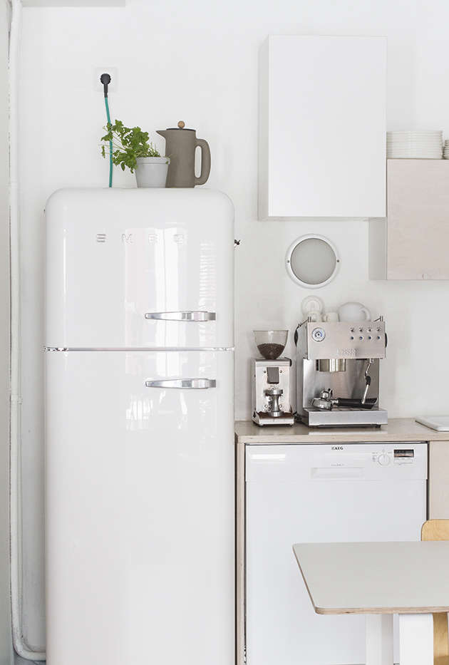 The biggest splurge, Anna tells us, was the vintage-style Smeg fridge. (West Elm offers a similar fridge-only Smeg for $1,999.) The laminate-topped table, the70/70 by Muuto, rests on square white aluminum supports.