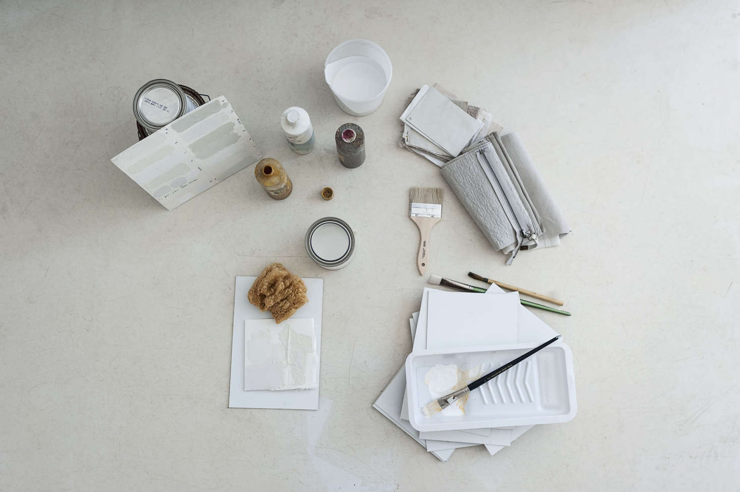An arsenal of tools and brushes in DIY Paint: Designer Michaela Scherrer Mixes Her Own Shades of White. Photograph by Matthew Williams.