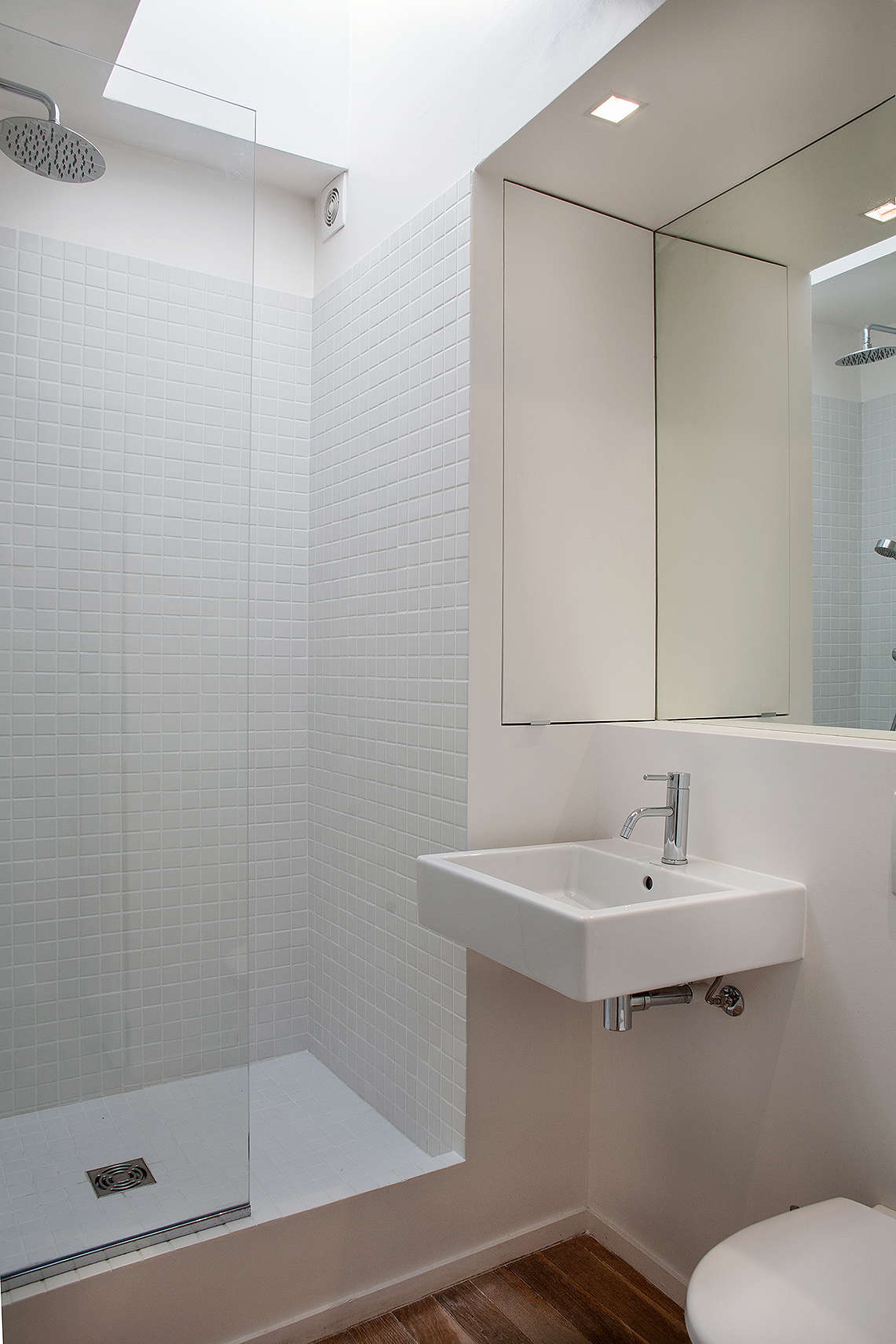 Inspirational white bathroom in a pact Paris apartment designed by Philippe Harden Remodelista