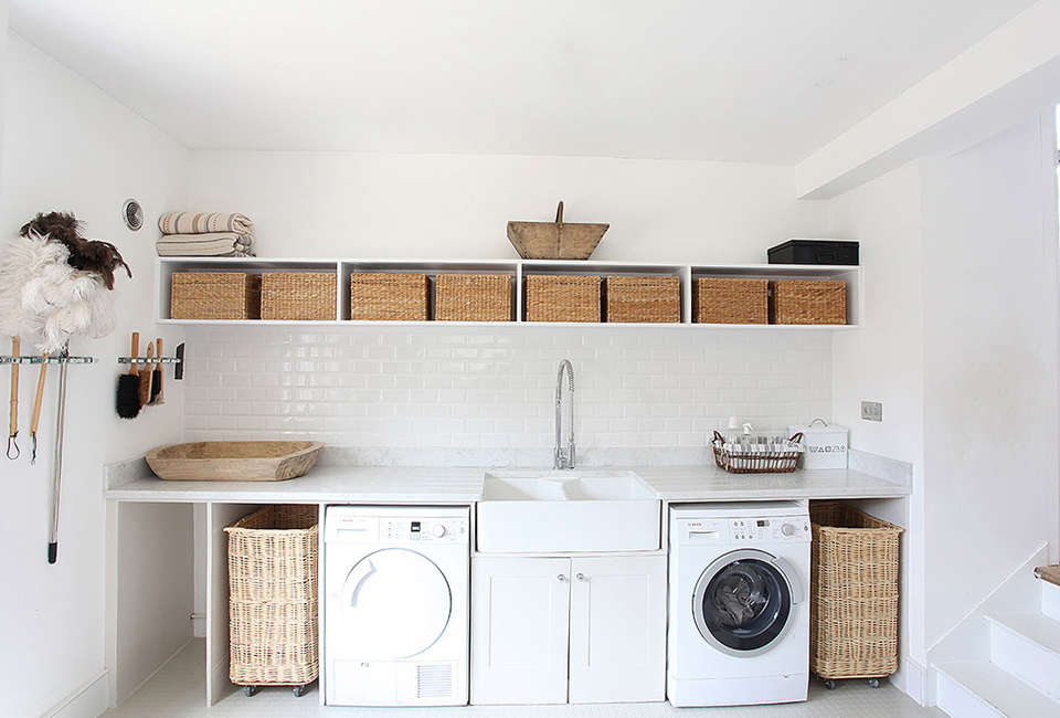 In A Bright Bath Laundry Wall Mounted Organizers Keep Clothes Brushes And Cleaning Essentials