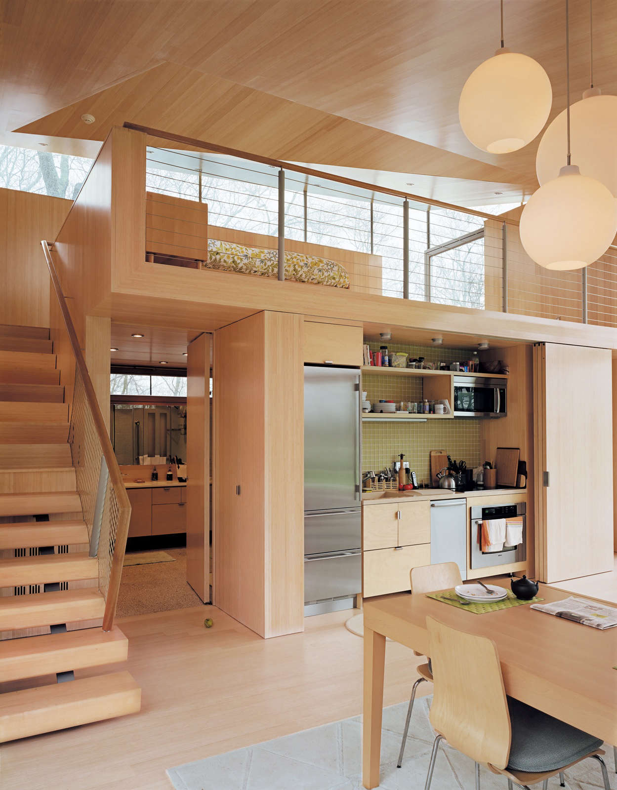A small kitchen concealed behind folding doors in a project by Gray Organschi Architecture.Photograph by Mark Mahaney.