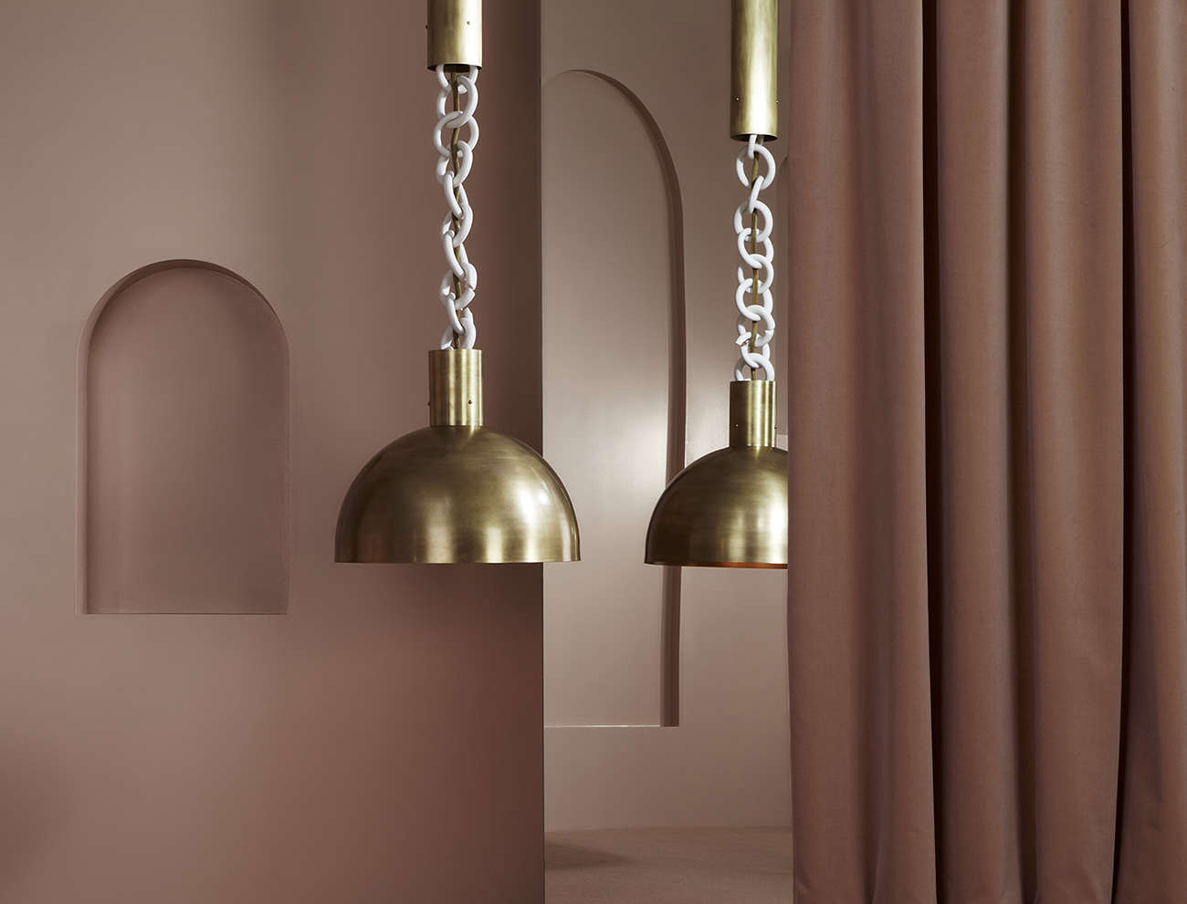 Apparatus Studio pendant lights with porcelain chain and brass shades | Remodelista