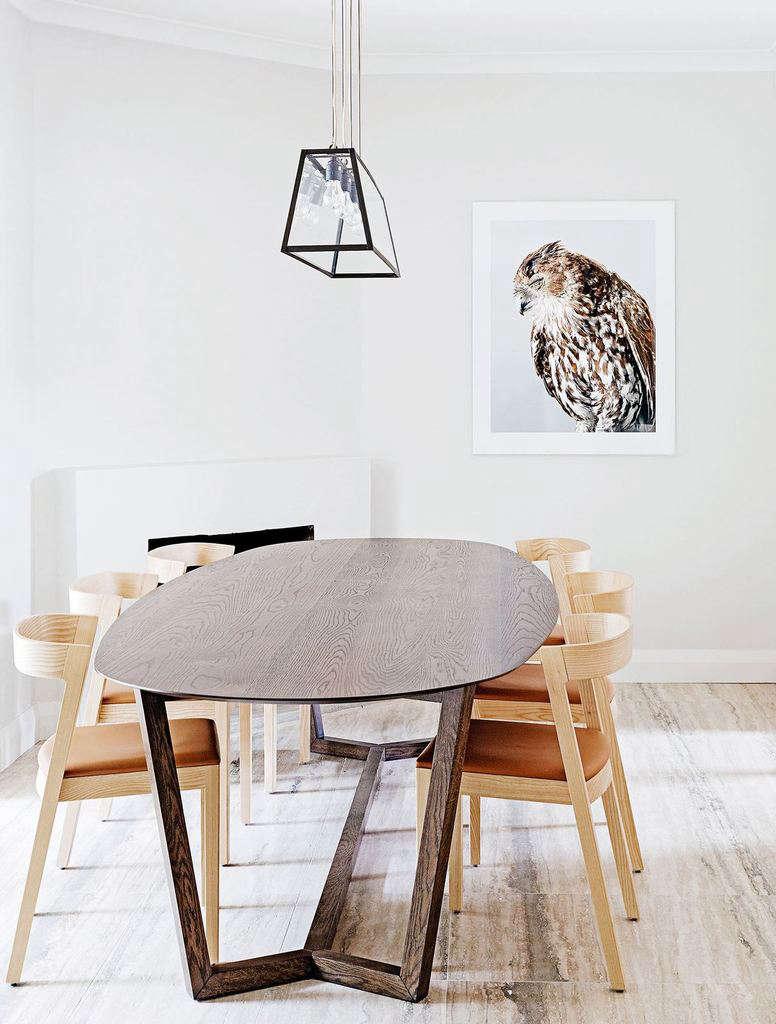 Travertine flooring in a modern dining room in Sydney interior designers Arent & Pyke of Sydney | Remodelista