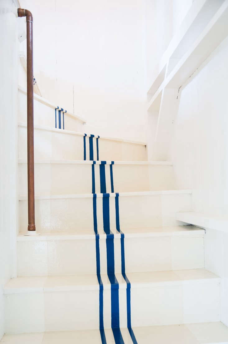 A stair runner alternative, on the cheap. For more, see Remodeling src=
