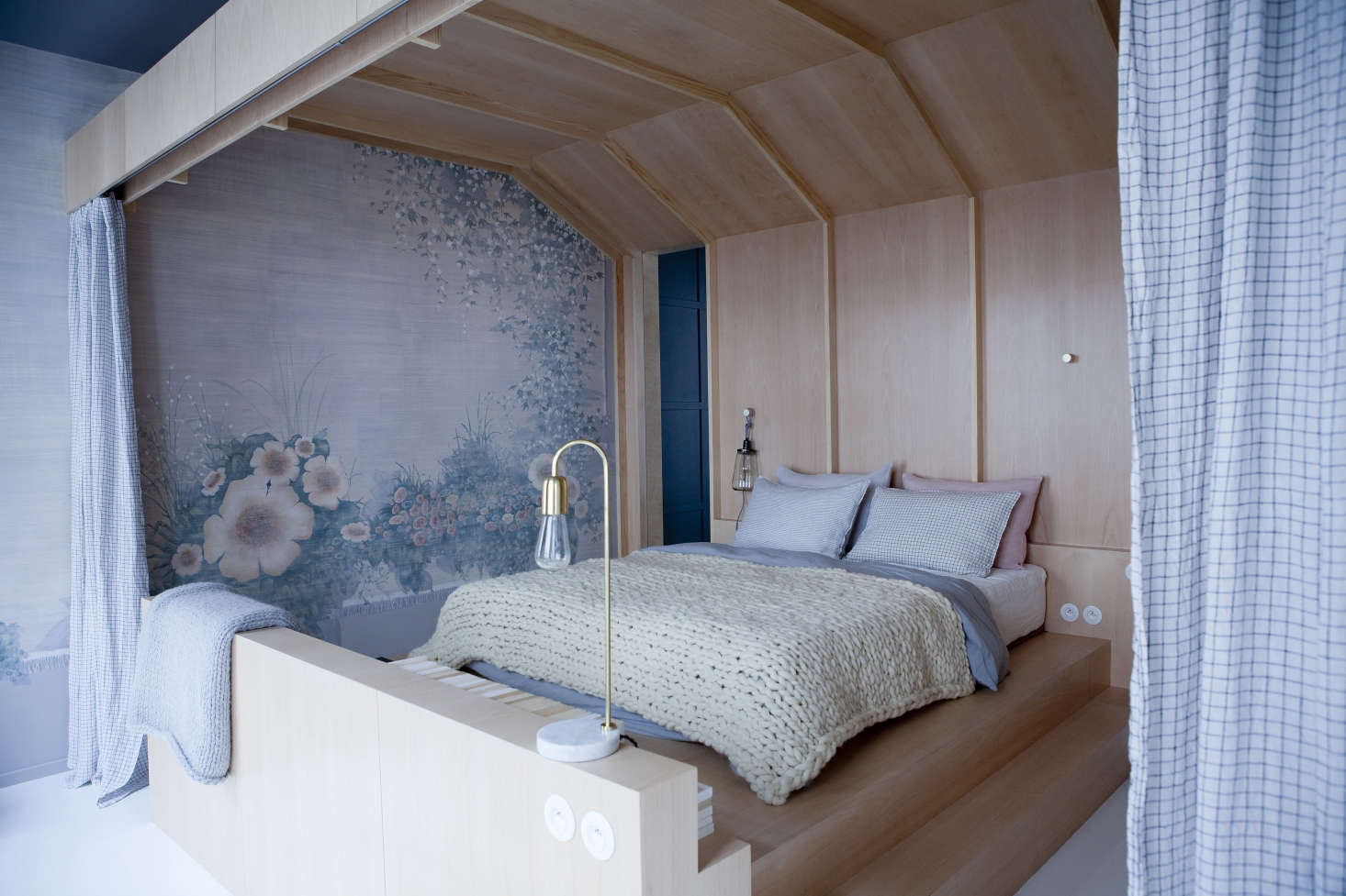 The cabin bedroom with tapestry-inspired painted mural at Chez Marie Sixtine, a guest apartment in Paris, Julie Ansiau photo   Remodelista
