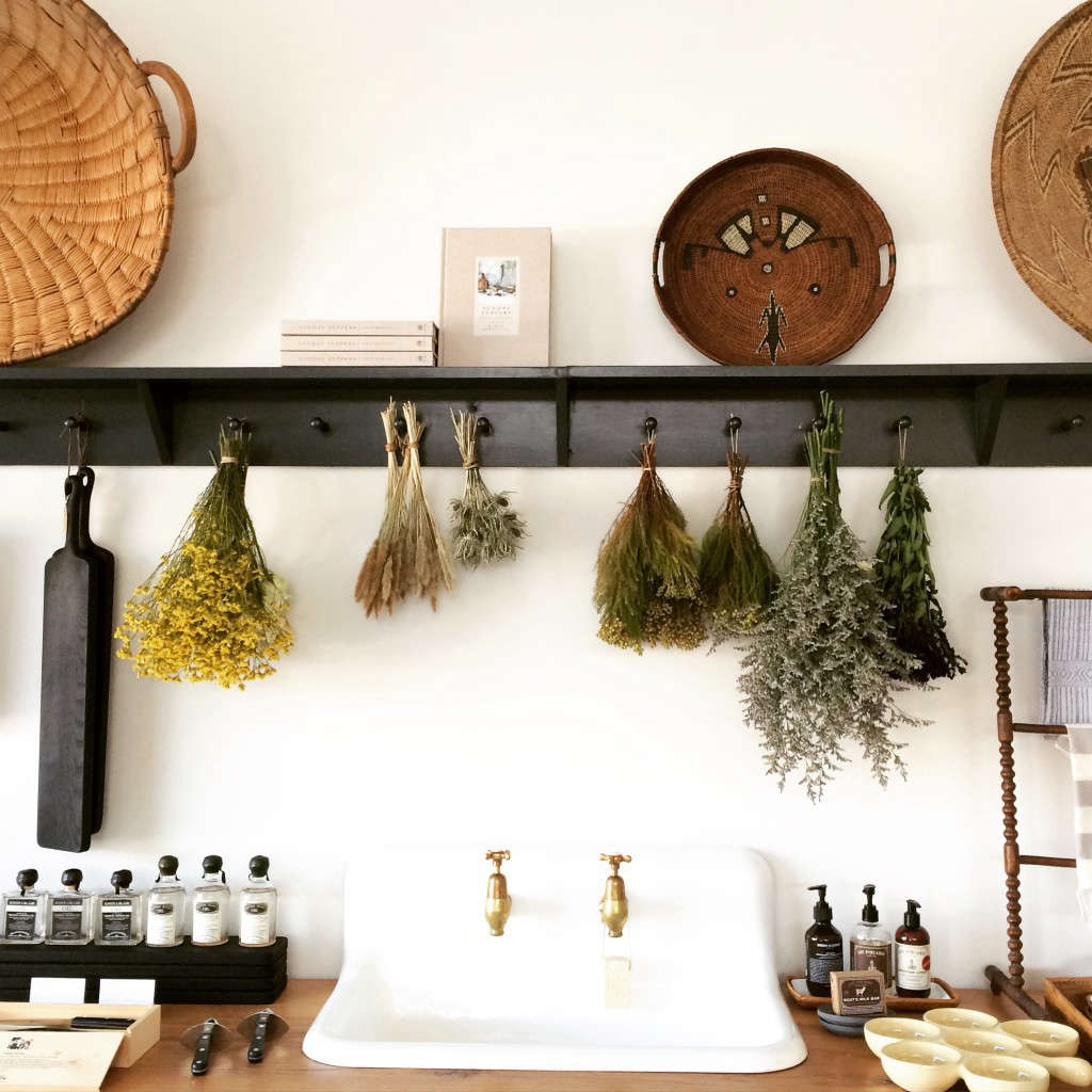 Black peg rails hold dried flowers in a Dallas shop; see Shopper's Diary: The Kitchen Sink and More at Set & Co.