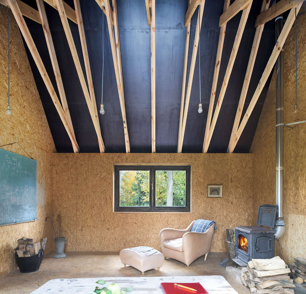 Soaring interior of a cabin in Belgium designed and built by London architecture firm De Rosee Sa Architects | Remodelista