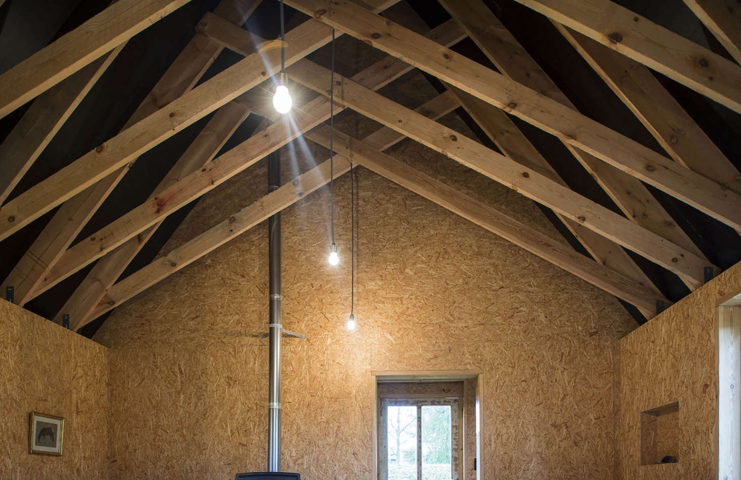 Scissor trusses in a cabin in Belgium designed and built by London architecture firm De Rosee Sa Architects | Remodelista