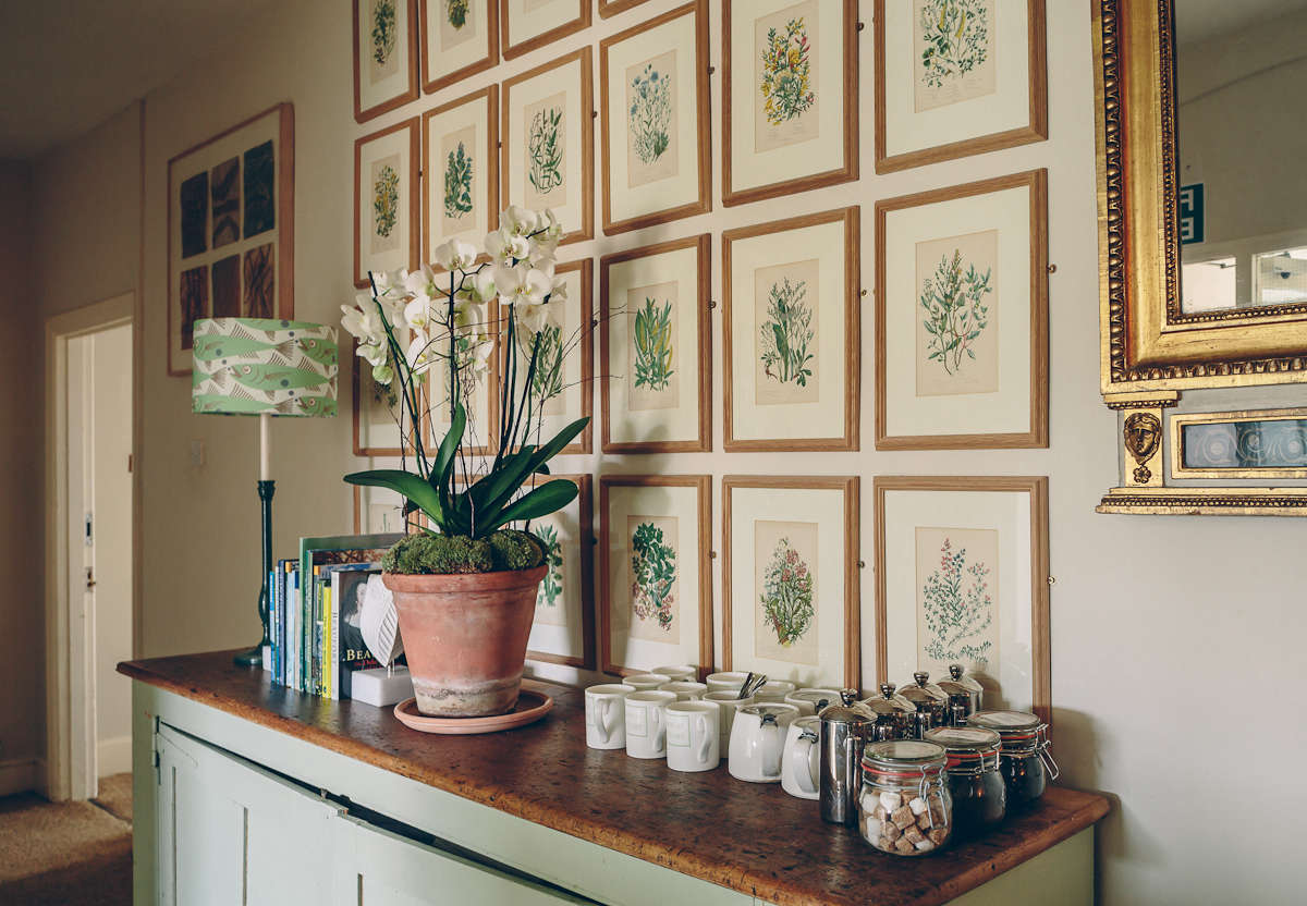 In the UK, a more formal arrangement: Wildflower botanical prints hang in a grid above the morning coffee station atThe Rectory Hotel: A Chintz-Free Country House in the Cotswolds.