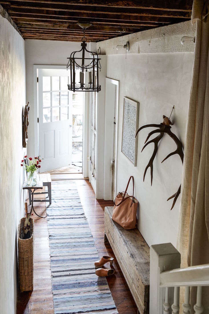 Hudson home_red chair_hallway_Marili Forastieri - A Historical Hudson, NY, Home Reimagined (European Antiques Included