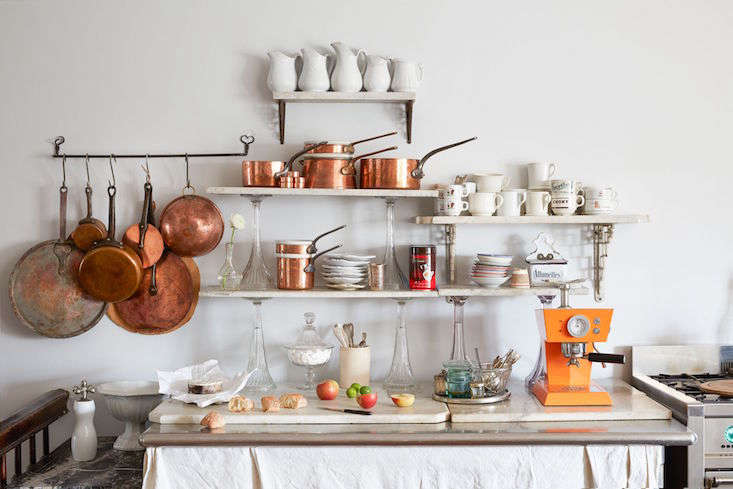 A practical use for multiple small scraps: open kitchen shelving (supported by sturdy brackets), as seen in A Historical Hudson, NY, Home Reimagined (European Antiques Included).