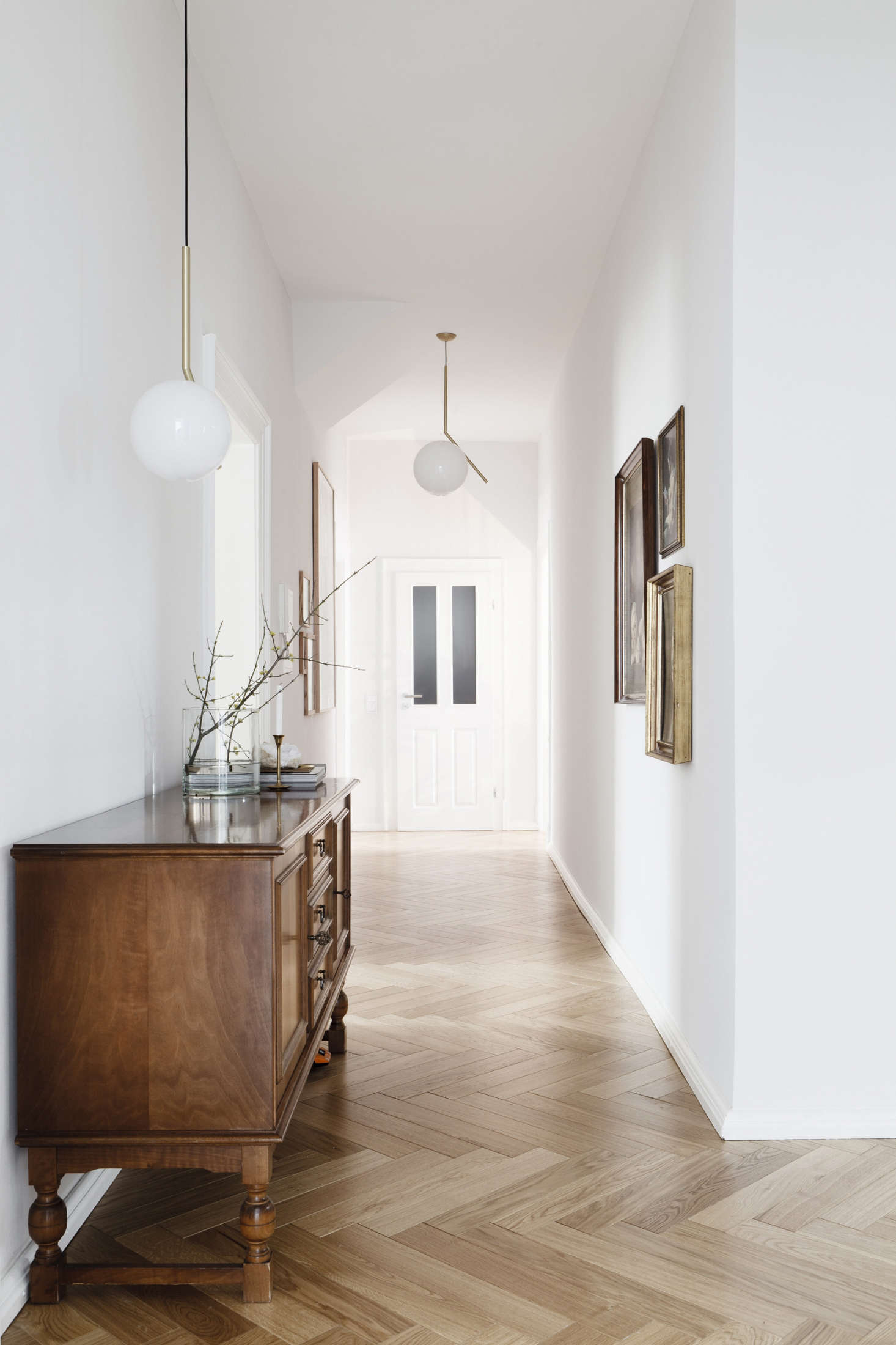 Herringbone floors in a German apartment by Leipzig-based Studio Oink, featured in Earthly and Ethereal: An Apartment Makeover by Studio Oink. Photograph by and courtesy of Studio Oink.