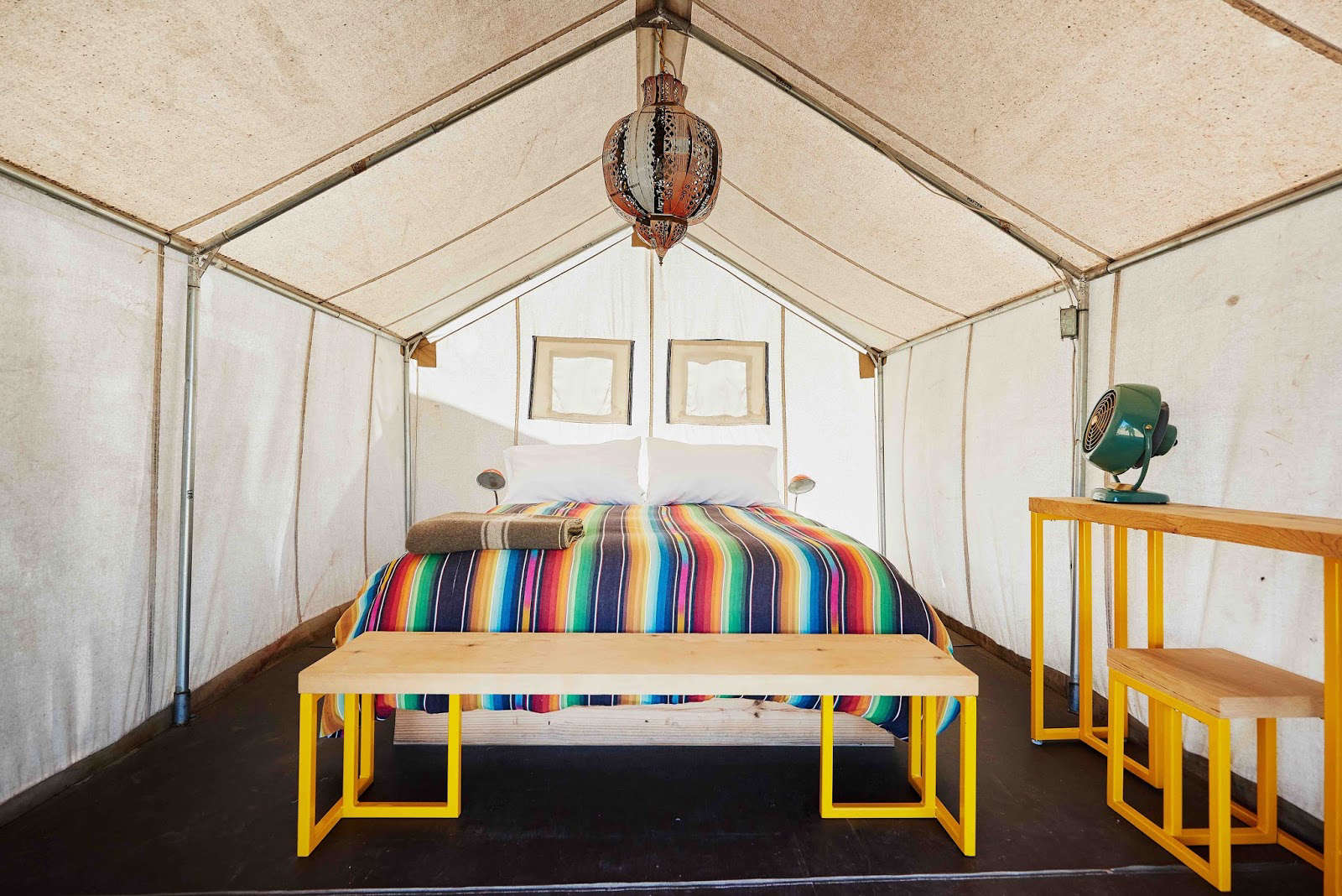 Above: Another Tent Interior With A Rainbow Duvet And Yellow Furniture.  Photograph From El Cosmico.