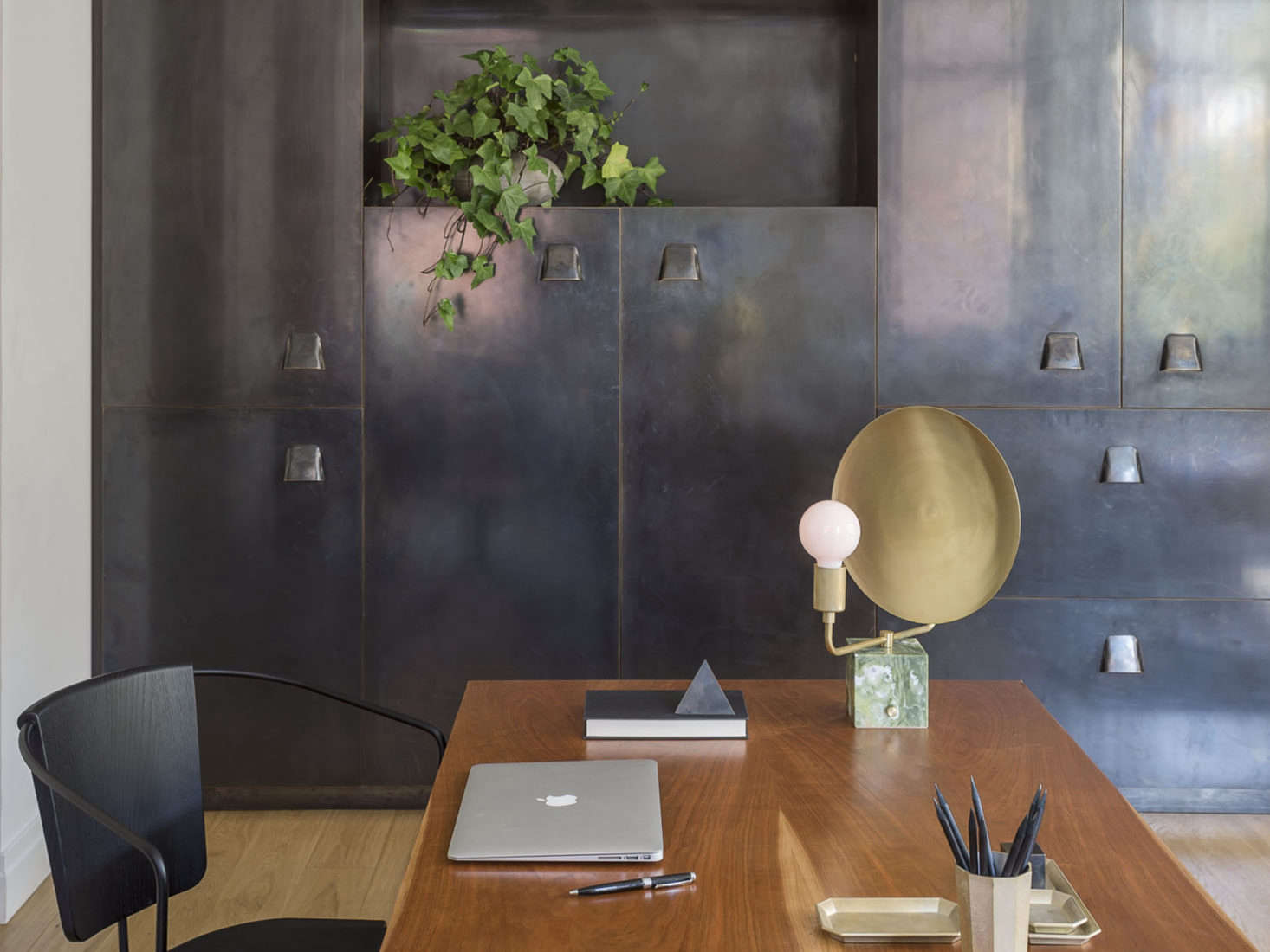 Blackened brass cabinets in an apartment remodel by Workstead, Matthew Williams photo | Remodelista
