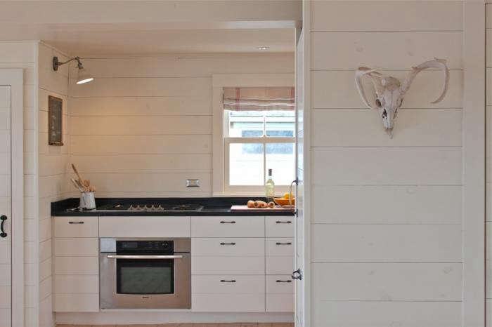 shiplap wall kitchen. shiplap kitchen installed in harbor cottage kitchen, photo justine hand wall e