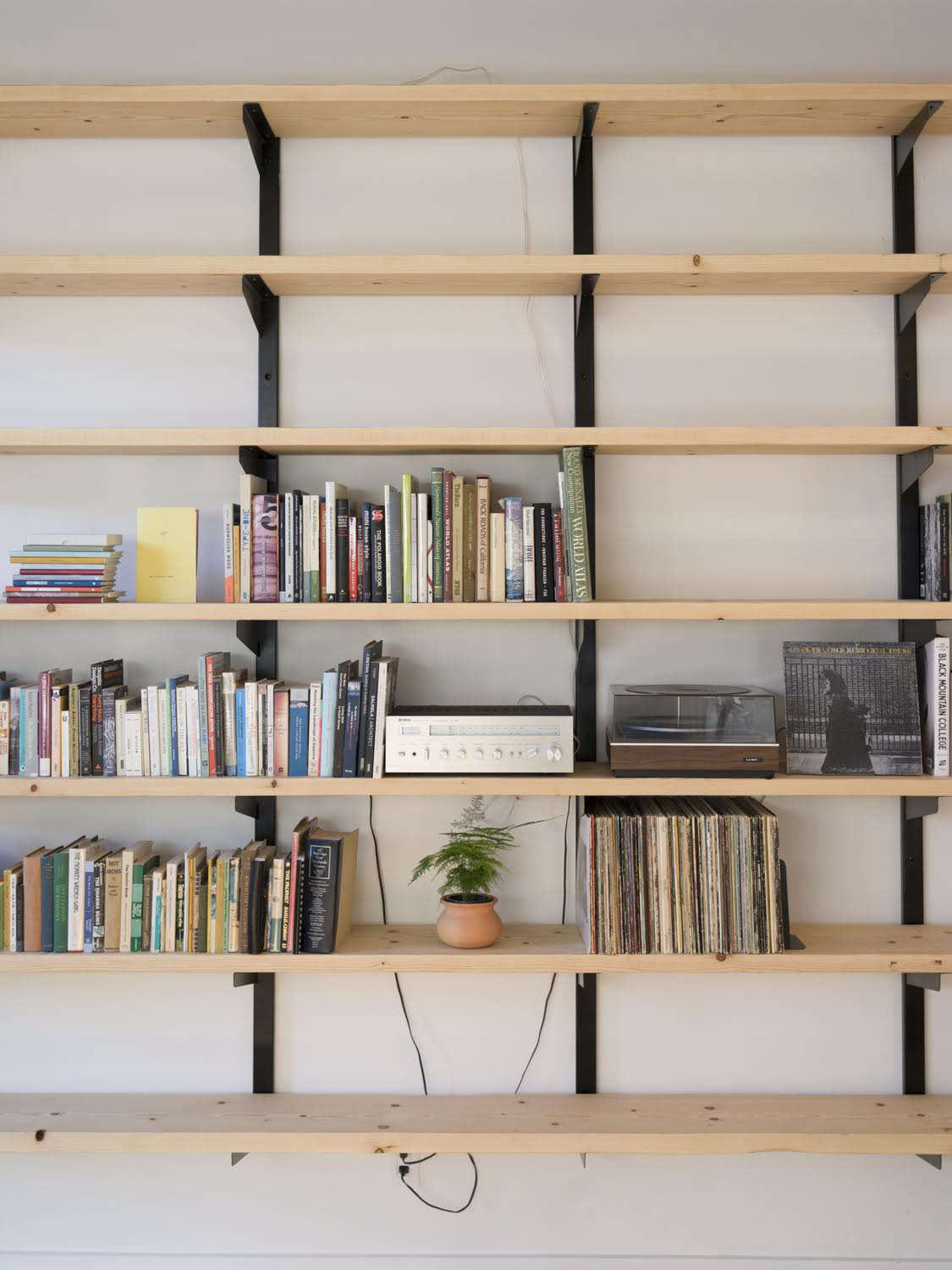 Asharinglibrary of books and records sits on shelves of locally milled fir with brackets by Phloem Studio.