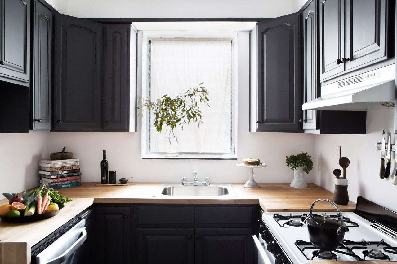 Designer athena calderone updated the brown laminate countertops in her rental kitchen with karlby birch countertops