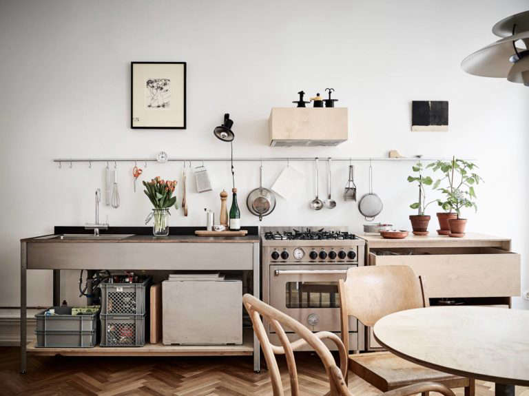 A Kitchen Made Up Of Stainless And Wood Components From Steal This Look:  Smart Storage