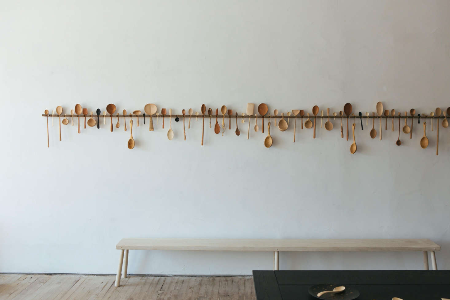 An array of hand-turned wooden spoons line the wall at the Blackcreek Mercantile & Trading Co. showroom in Kingston, New York. Photograph by Eberhart Smith from A New Store from Blackcreek Mercantile & Trading Co. in Kingston, New York.