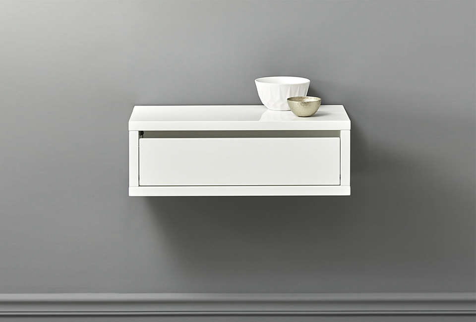 Cb2 S Slice White Wall Mounted Storage Shelf Has A Drawer Integrated Into Its High