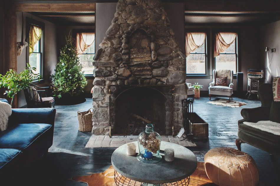 The floor-to-ceiling rustic stone fireplace in the lounge area was uncovered beneath a layer of drywall. Both the ceilings and floors received a new coat of black paint.