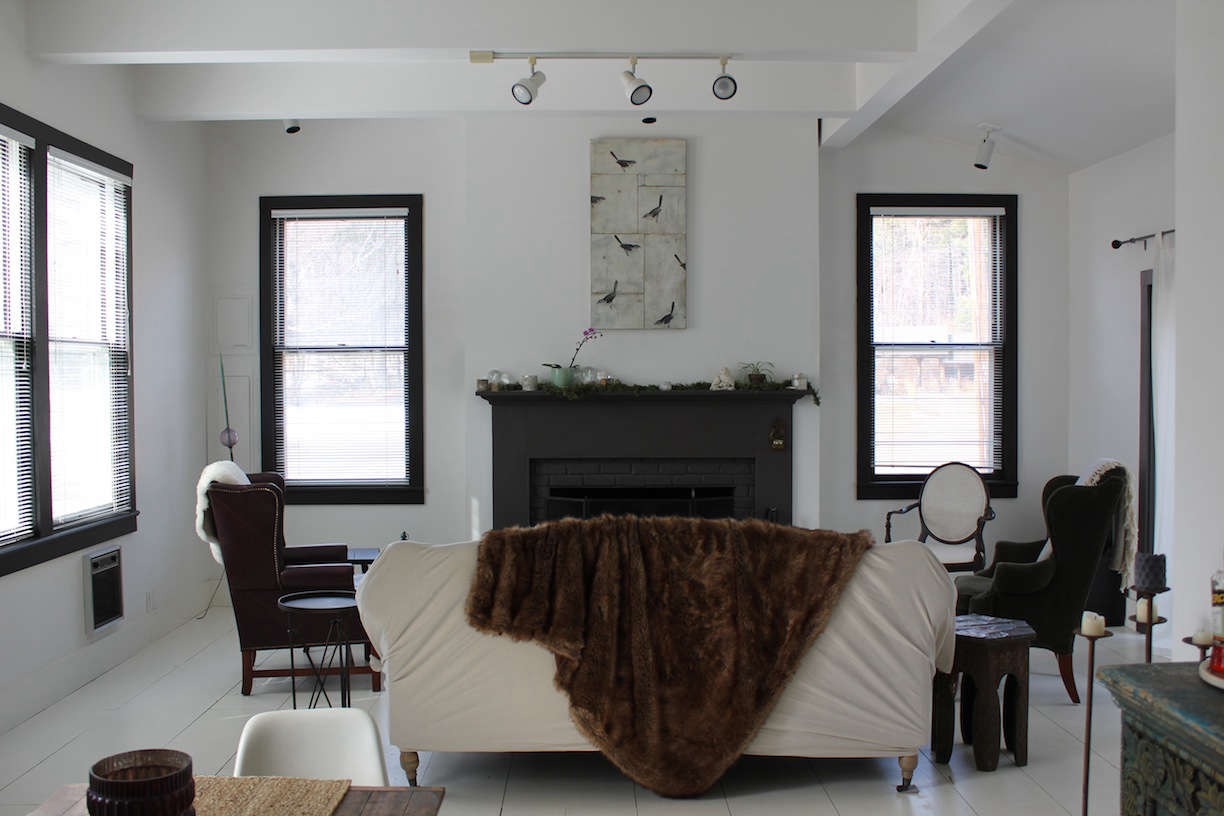 The interior of the cottage received a head-to-toe coat of white paint; window frames are painted black for contrast.