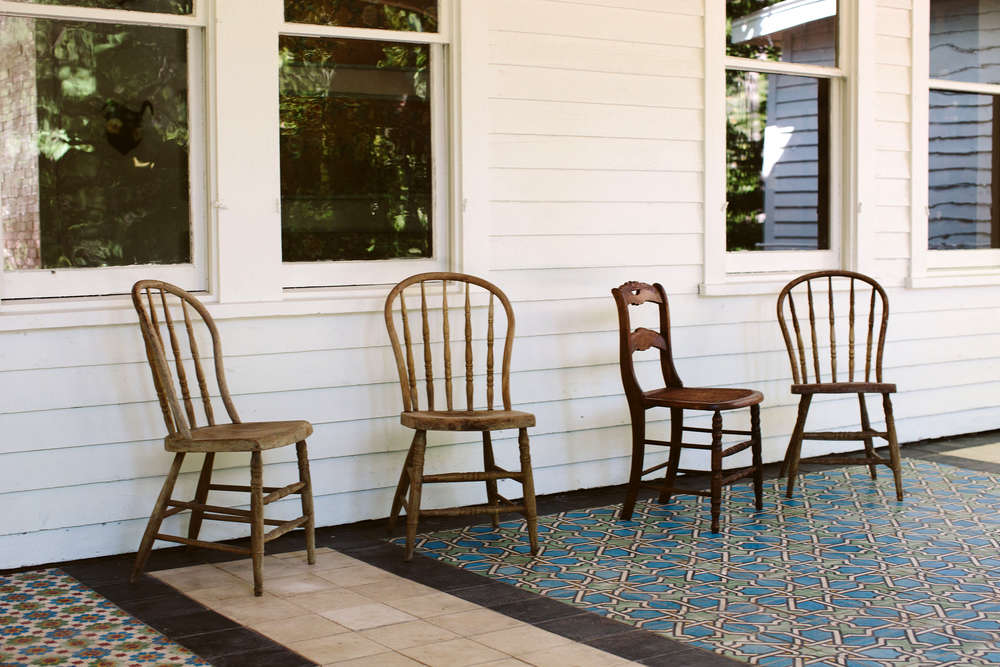 The porch is tiled in patchwork Moroccan tiles the owners found in a Brooklyn warehouse.