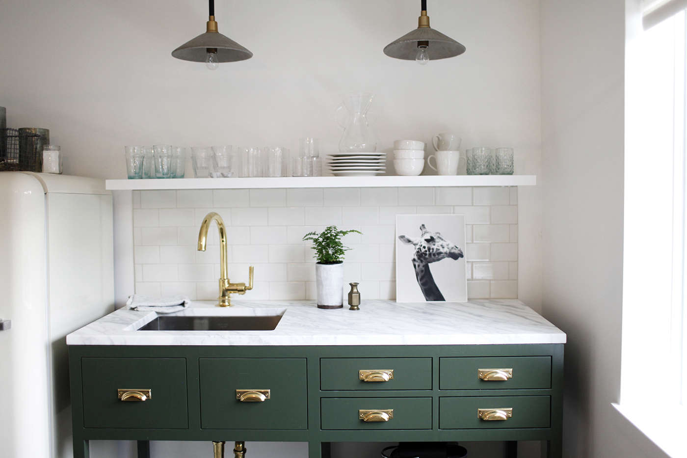A petite kitchen with a repurposed marble slab, salvaged from an earlier project. SeeKitchen of the Week: A Before & After Office Rental in Seattle.