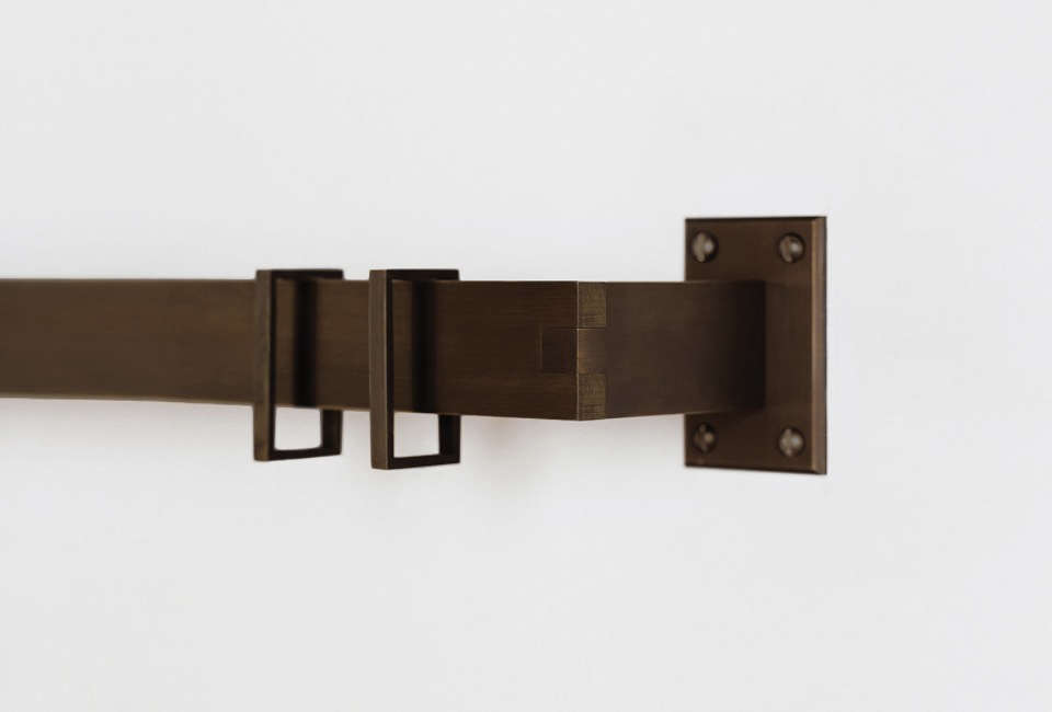 """Dave Swetz of Butler Armsden Architects in San Francisco chose Browning's Langeais Drapery Hardware, which he calls """"beautifully detailed and hard-lined contemporary hardware in a world of circles, rings, and rods."""" It's shown here in oil-rubbed bronze."""