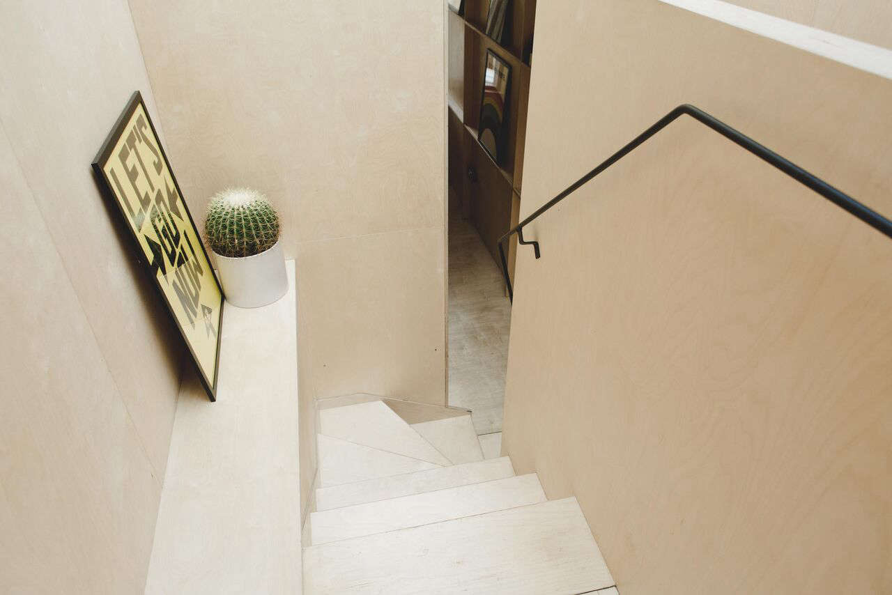 In Simon Astridge's Plywood House: Raw Materials in a Victorian Remodel, the staircase is made of pale birch plywood.