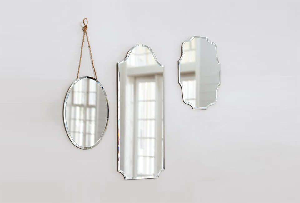 These Eleanor Frameless Mirrors from Pottery Barn have a vintage look. They come in two sizes; $99 for the small and $src=