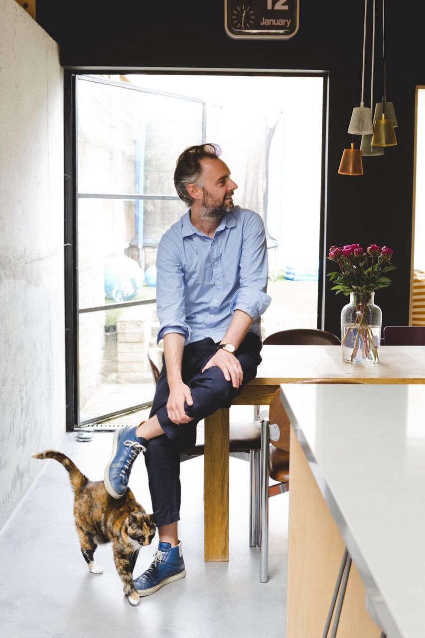 Architect Simon Astridge in the kitchen at Plywood House, a London Victorian remodeled, photo via FvF | Remodelista