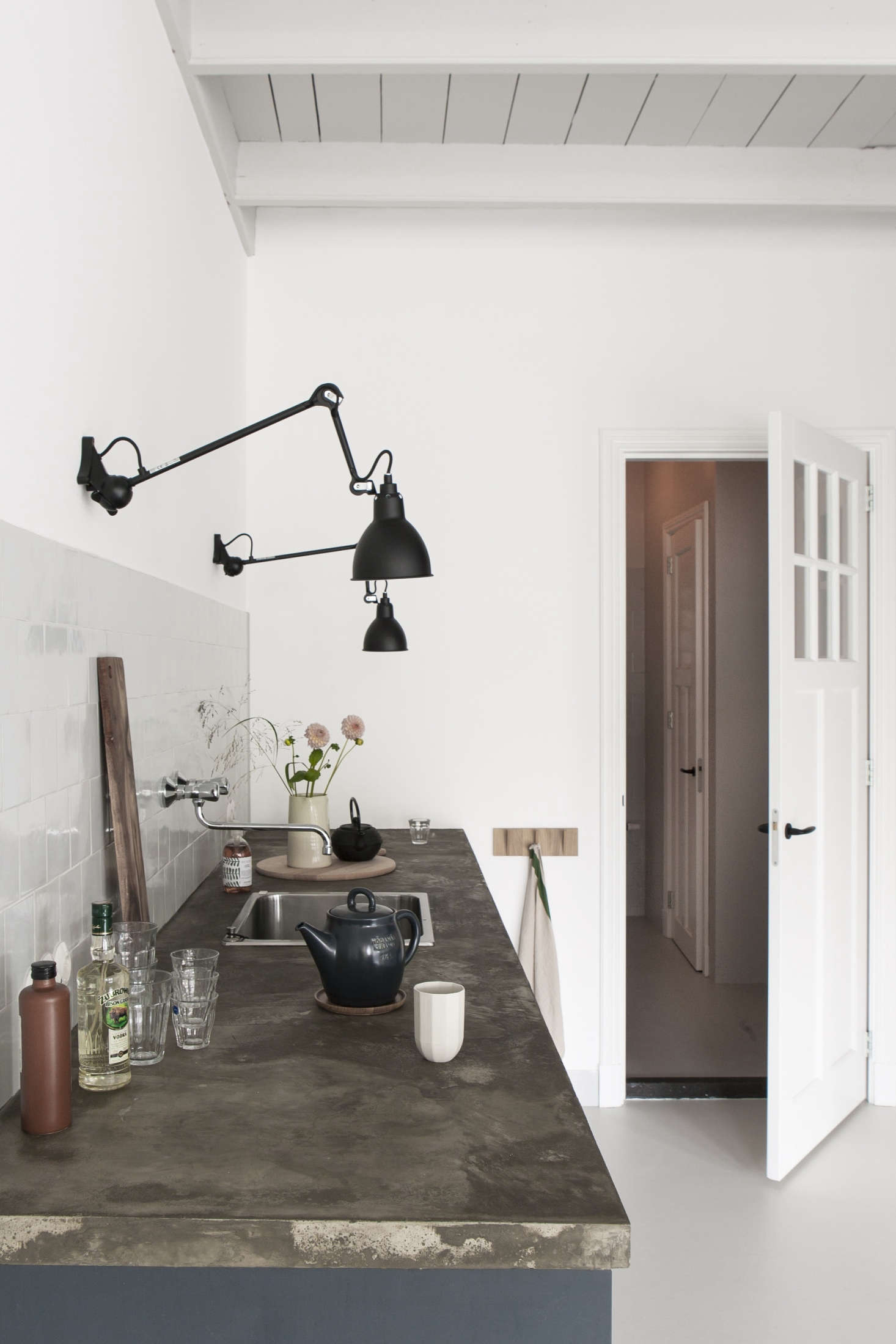 The adjustable sconcesareFrench classics byLampe Gras.