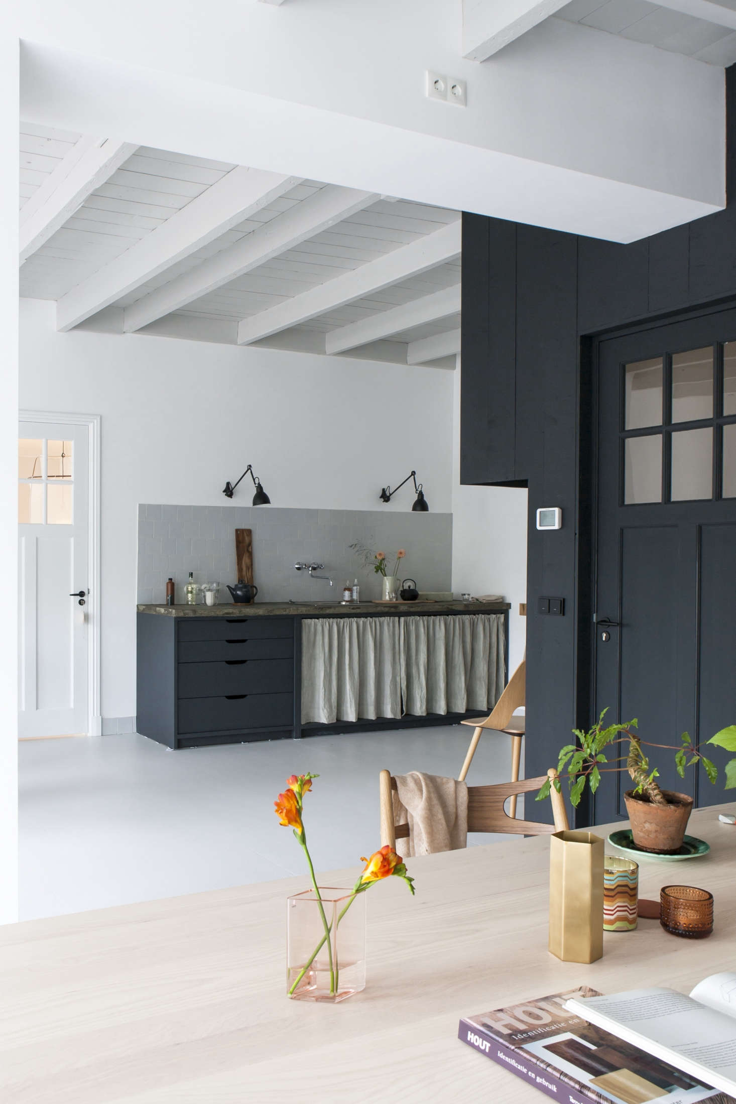 A curtained kitchen with a small tiled backsplash fromKitchen of the Week: The Curtained Kitchen, Dutch Modern Edition.