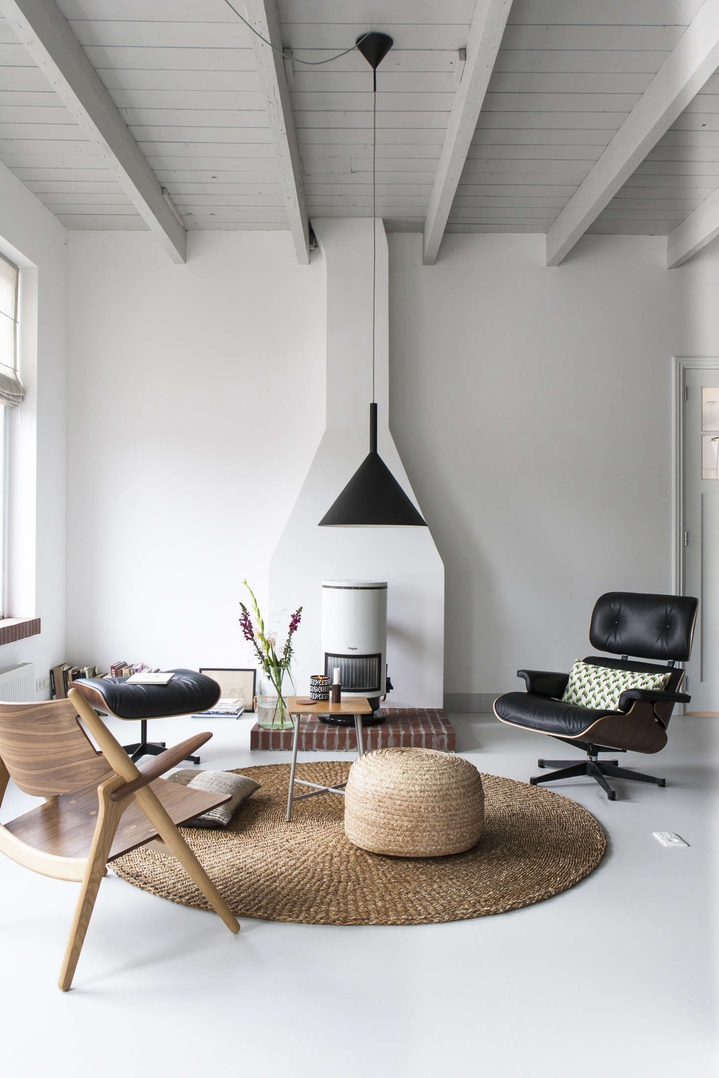Scandi modern living area in the studio of Dutch interior designer Christen Starkenburg of Interieur-Plus at Jan de Jong, her family's design shop in Friesland, the Netherlands | Remodelista