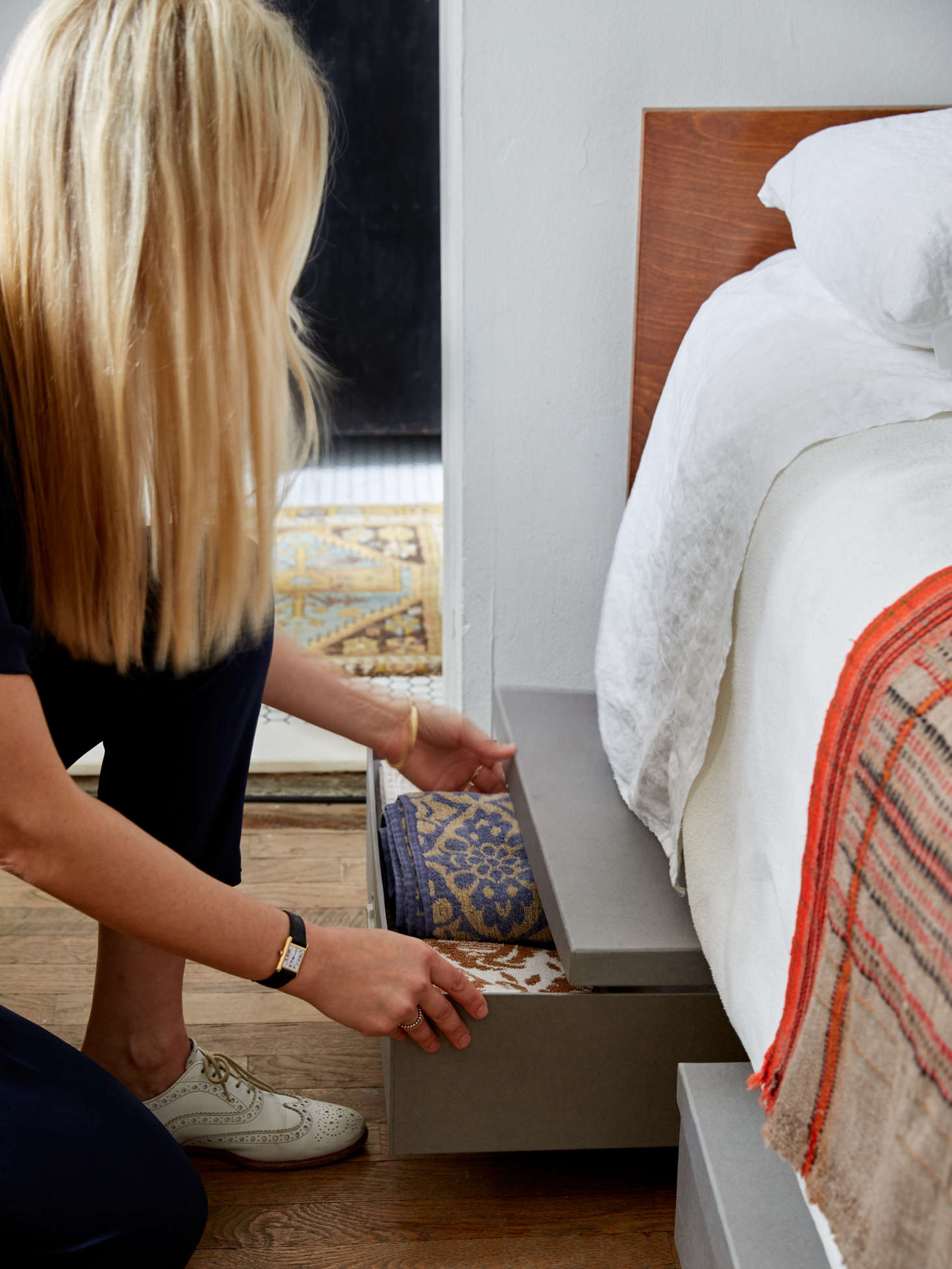 Renate Bokalo's under-the-bed storage using archival cardboard boxes from the Container Store