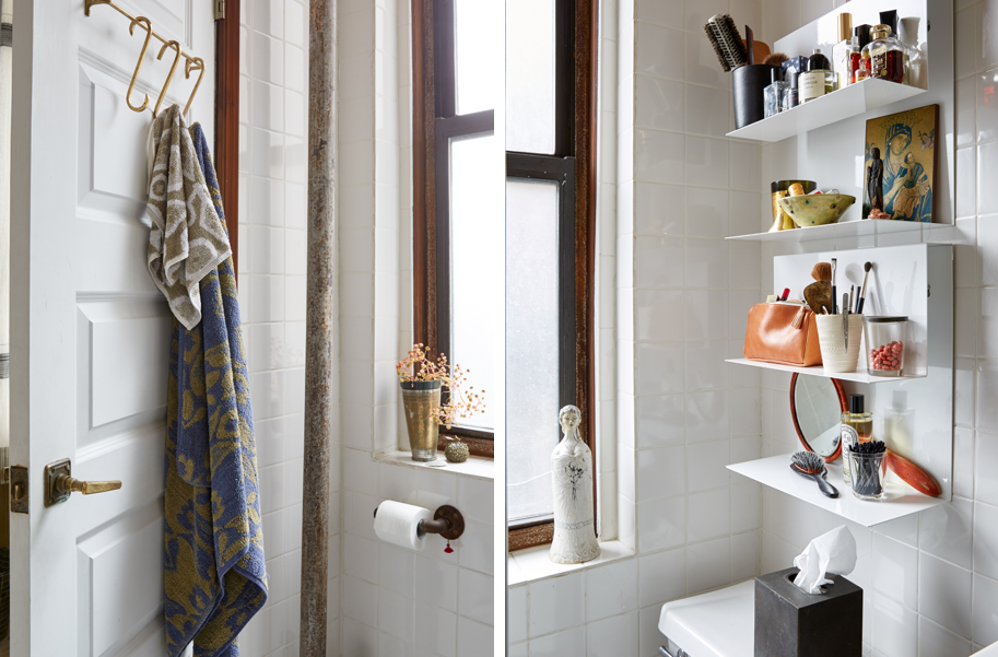 Small bathroom storage solution: wall shelves and door hooks